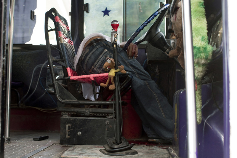 Bus driver Manuel Verduzco Salgado, 22, lies dead on his bus seat after he was shot by unknown men, Acapulco, Mexico