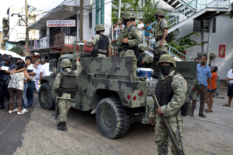 Mexican marines secure a murder scene in which a bus driver was assasinated, Acapulco, Mexico