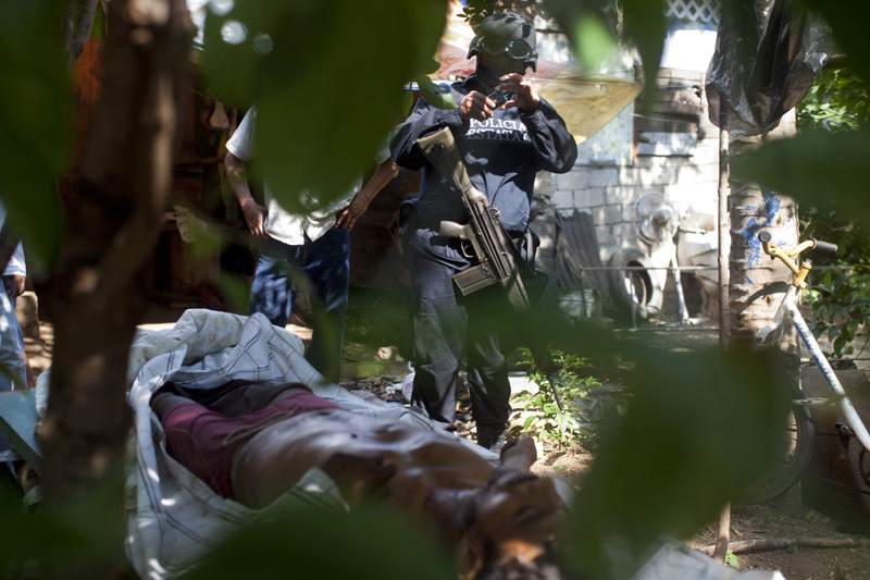 Jesus Hernandez Valente, 28, lies dead near his home after he was tortured by unknown men, Acapulco, Mexico