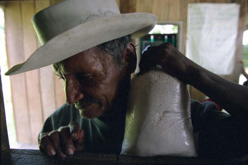 A farmer waits to sell his cocaine base produce to a dealer in the town of Peñas Coloradas, Colombia