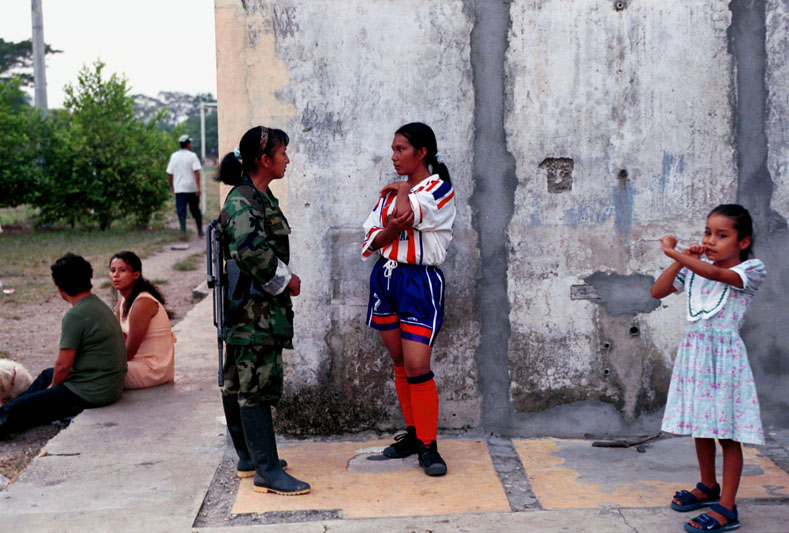 A FARG guerrilla chats with a woman after a football match in the town of Santa Fe, Colombia