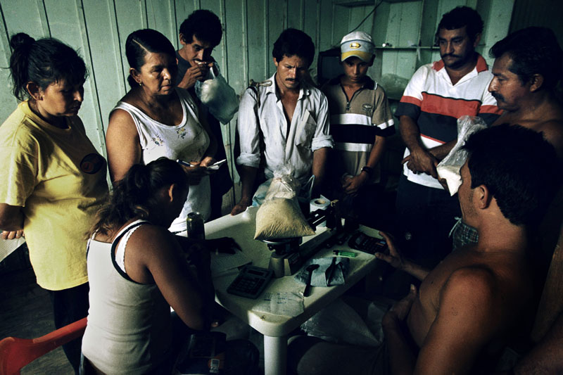 Farmers sell their cocaine base produce to a dealer, Santa Fe, Colombia