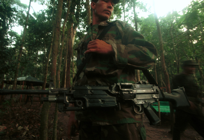 FARC special forces guard the camp of a high level commander, a prime target for the Colombian army, Caquetá, Colombia