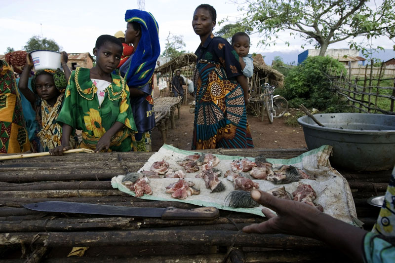 Street market / A man sells pork meat at a street market in Fizi, DR Congo
