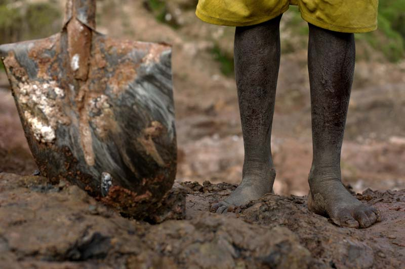 A boy mines for coltan stones in South Kivu, DR Congo.