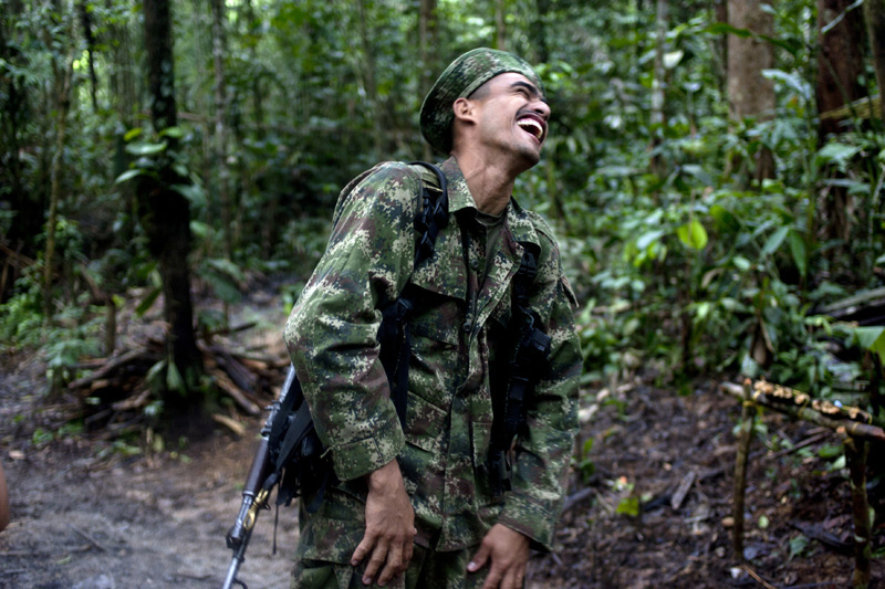 Revolutionary Armed Forces of Colombia, FARC, guerrilla, Carlos, aka, Duban laughs at a camp the mountains of Meta, Colombia