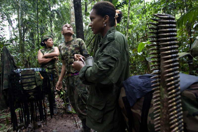 Revolutionary Armed Forces of Colombia, FARC, guerrillas watch a pasing by plane at one of their camps in the mountains of Meta, Colombia