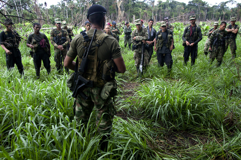 Revolutionary Armed Forces of Colombia, FARC, guerrillas form to review the day's chores before advancing towards a new mission in the mountains of Meta, Colombia