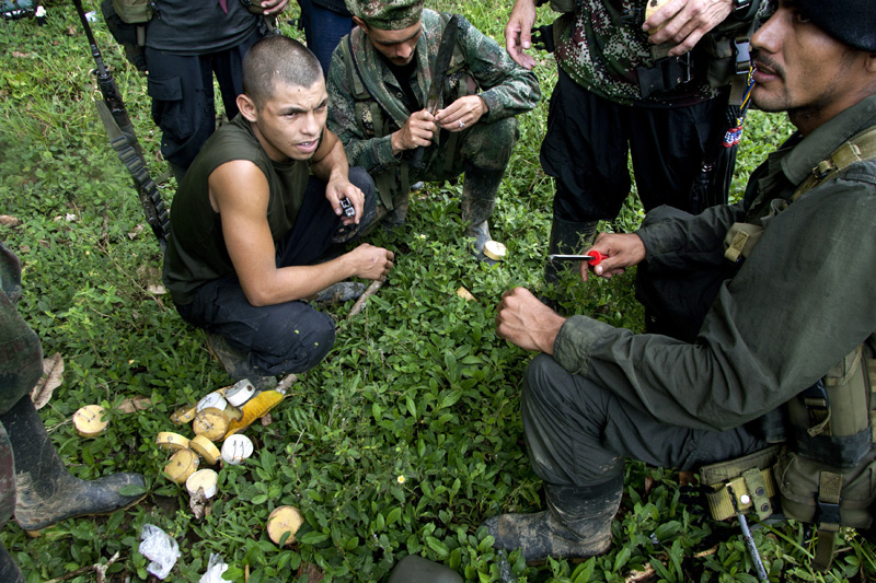 Revolutionary Armed Forces of Colombia, FARC, guerrillas prepare anti personel land mines to be buried in the suspected path of a chasing colombian army platoon in the mountains of Meta, Colombia