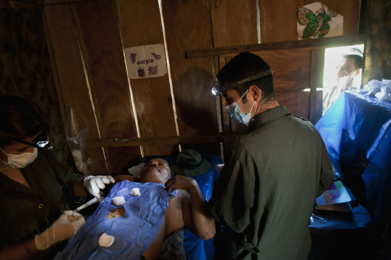 A Revolutionary Armed Forces of Colombia, FARC, doctor performs surgery to a civilian patient in what the group describes as strategies to win back the civilian population support, Meta, Colombia