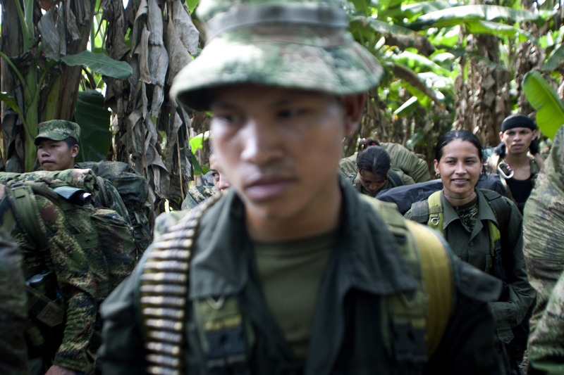 Revolutionary Armed Forces of Colombia, FARC, guerrillas form before advancing towards a new position in the mountains of Meta, Colombia