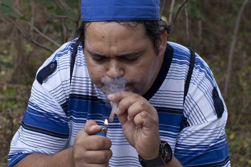 A man smokes crack in the Hunts Point section of the South Bronx, NY, USA