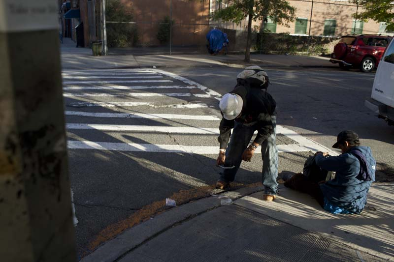 A couple of drug users hanging on a street of the Bronx, NY, USA