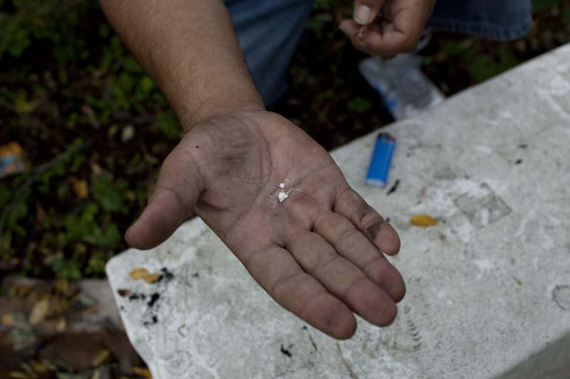 A drug user displays a crack cocaine dose, the Bronx, NY, USA