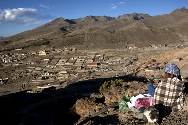 A woman guards the mouth of a mine in Potosi, Bolivia, preventing thieves from stealing tools or minerals.