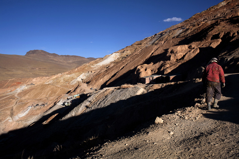 A miner walks home after his shift ends inside the Rich Mountain in Potosi, Bolivia.