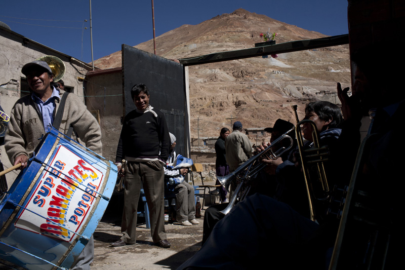 Festivals mean brass bands and plenty of food and beer for miners' families in the Calvary neighborhood of Potosi, Bolivia.
