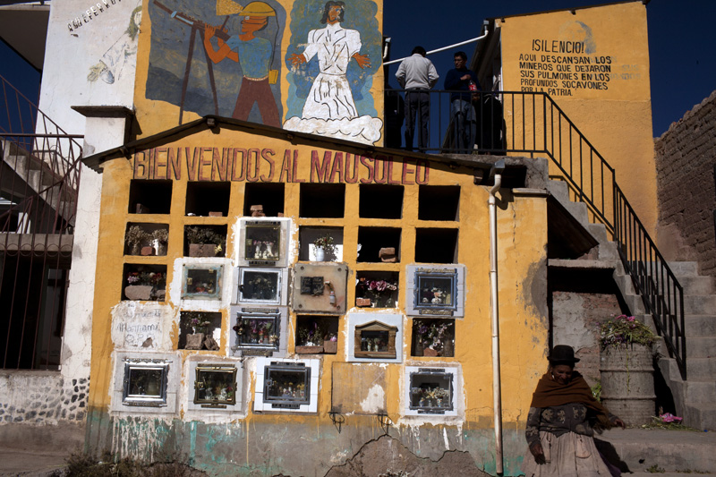 A family pays respects to a miner who died inside the Rich Mountain in Potosi, Bolivia. With dozens of deaths taking place each year inside the mountain, miners long ago came up with a brutally fitting moniker for their workplace: the mountain that eats men.