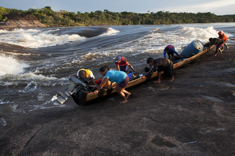Miners pass through the Zamuro rapids, on their way to Puerto Inirida, Colombia.