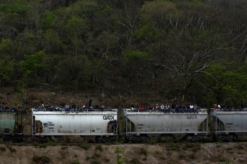 "Hundreds of illegal immigrants ride ""The Beast"", a cargo train that will get them closer to their american dream, Chiapas, Mexico"