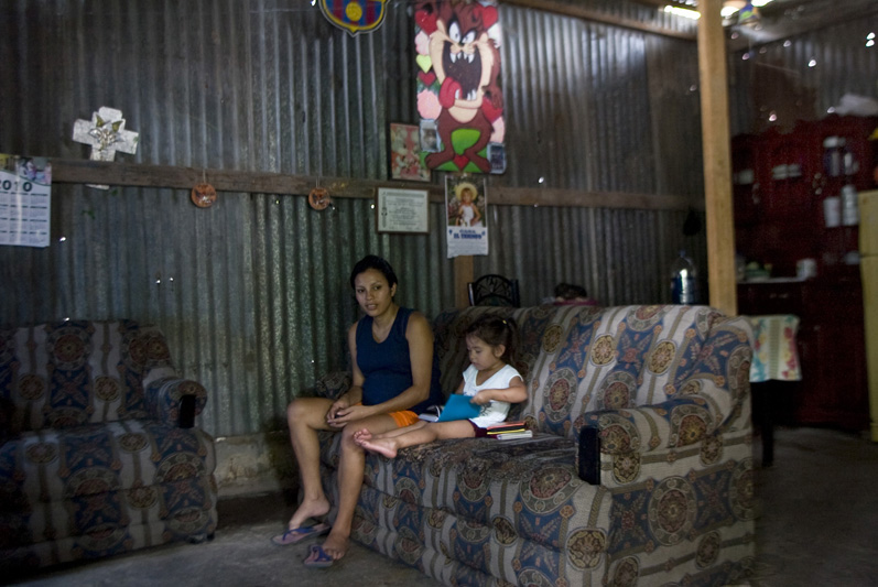Jessica Ochoa's Daughter Kathi, 2, and sister, Laura Ochoa, 23, sit at their home in San Salvador, El Salvador