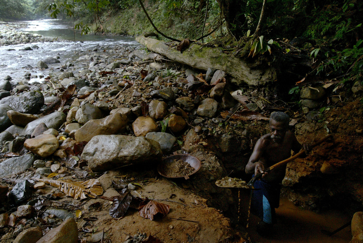 A gold miner at work in the Acandiseco river, Colombia, 2007.