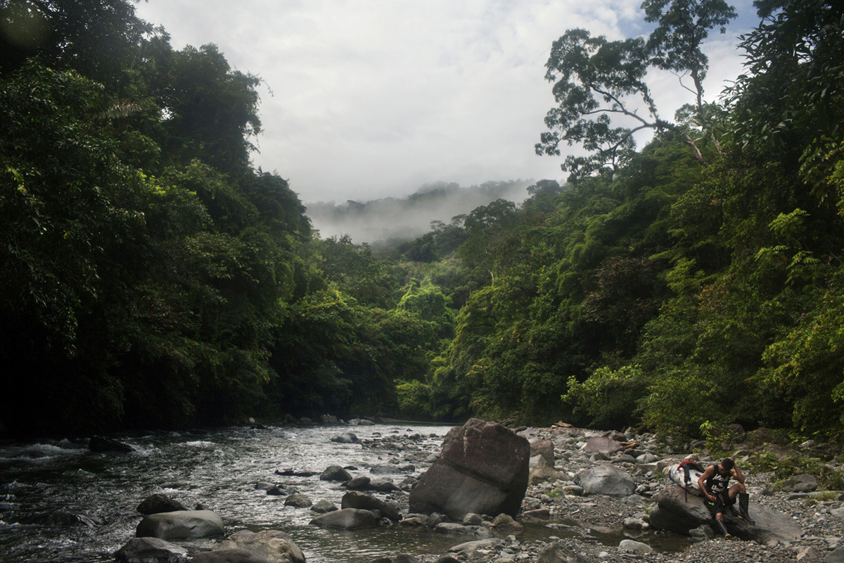 A porter rests in the Tuquesa river in Panama, 2017.