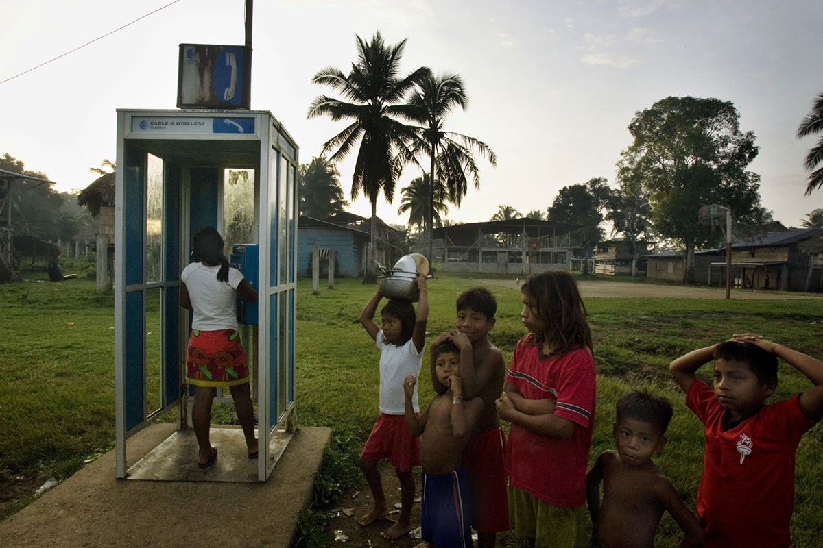 Embera indigenous wait on line to make phone calls, Piedras Blancas, Panama, 2007.