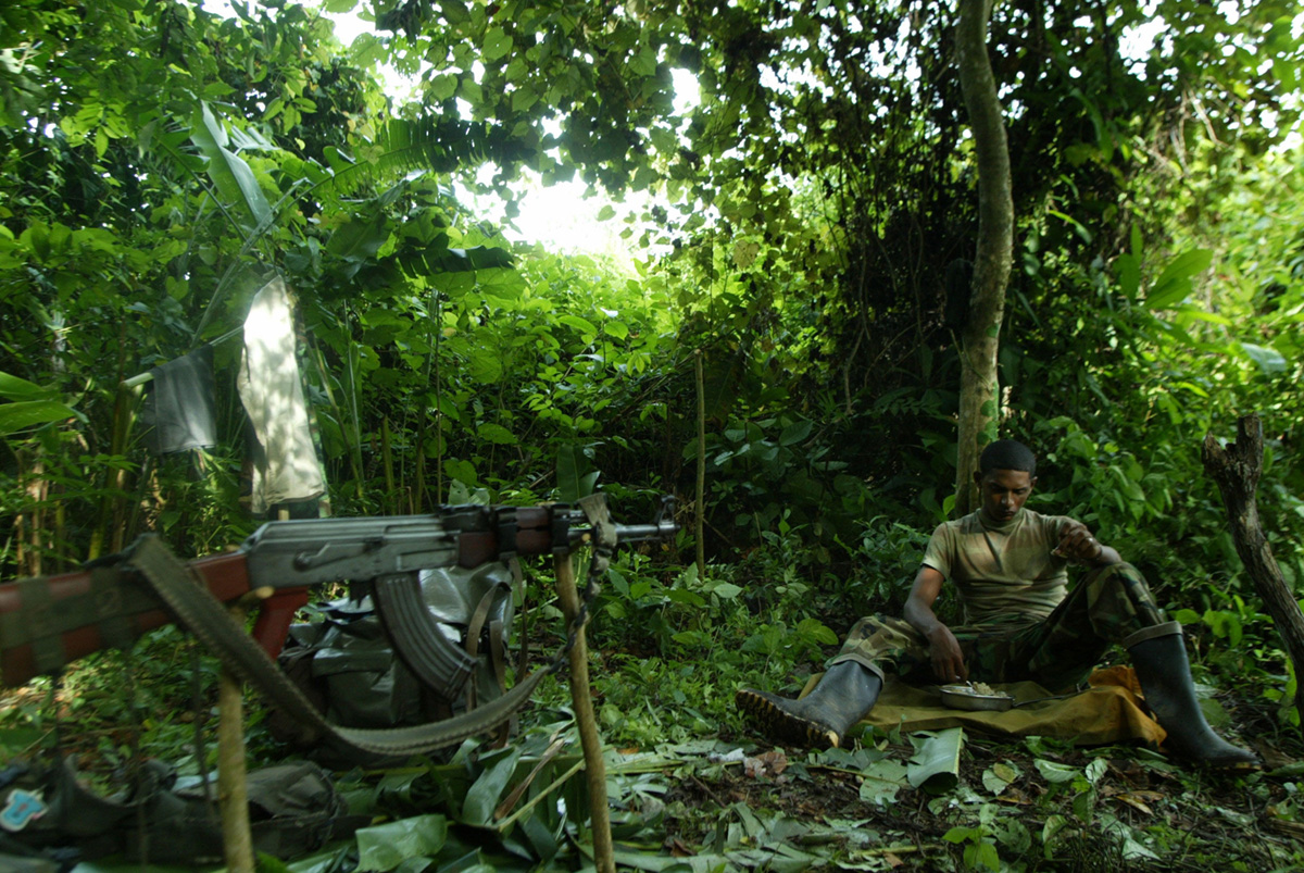 A paramilitar rests at one of their severals camps near the town of Chugandi, Colombia, 2005.